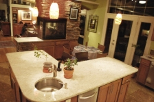 HONEY CABINETS WITH GRANITE TOPS